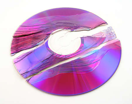 shiver: Scratched and broken purple DVD or CD.