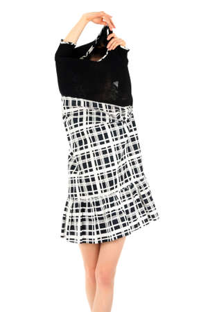 women undressing: Young woman taking off black and white stylish dress.