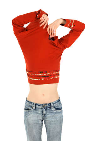 undressing girl: Funny woman in jeans takes off an orange shirt. Stock Photo