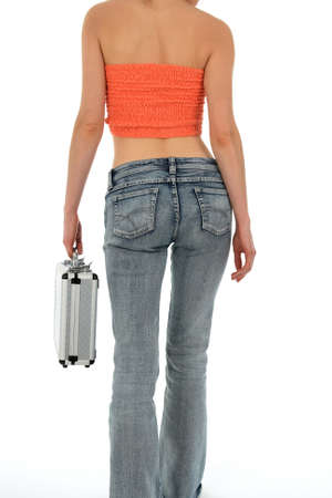Beautiful slim woman in blue jeans carrying a metal case. photo