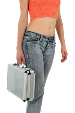 Young woman in blue jeans carrying a metal case. photo