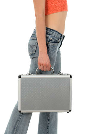 Young woman in blue jeans with metal suitcase. photo