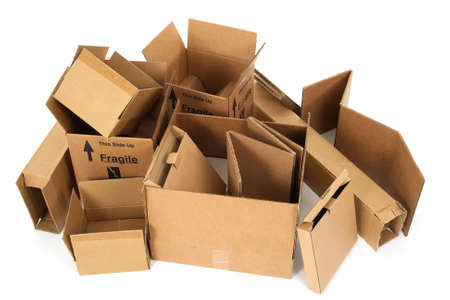 Pile of open cardboard boxes on white background.