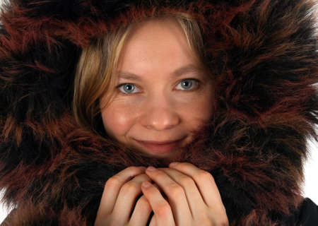 Portrait of smiling young woman with a fur hood. photo