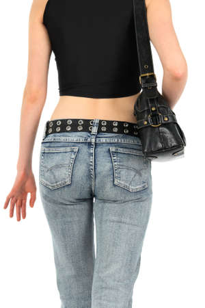 Urban young woman in blue jeans, with handbag.