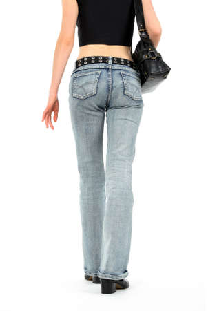 Urban young woman with handbag, wearing blue jeans and leather belt. Stock Photo - 2710222