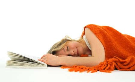 coverlet: Cute girl fallen asleep with an open book. Stock Photo