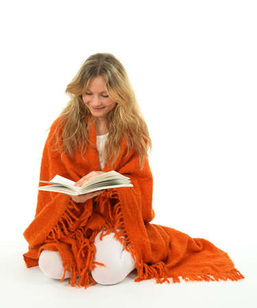 coverlet: Longhaired girl reading a book, smiling.