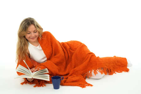 coverlet: Nice cozy girl reading a book, smiling.