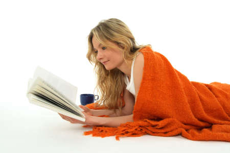 coverlet: Nice cozy girl reading a book, relaxed.