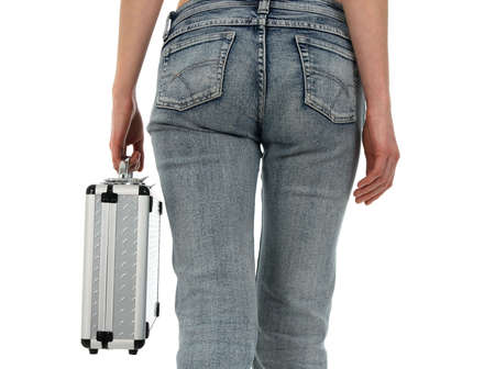 Woman in blue jeans carrying a metal case. photo