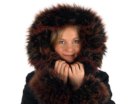 Portrait of smiling winter girl with a fur hood. photo