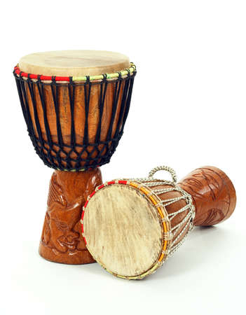 djembe: Two carved African djembe drums on white background.