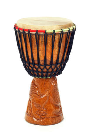 djembe: Carved African djembe drum on white background. Stock Photo