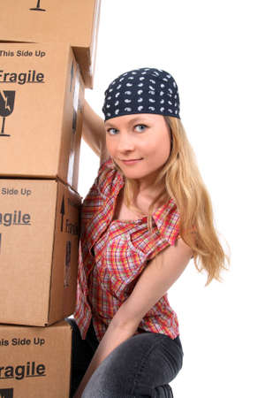 Portrait of a young woman holding a stack of cardboard boxes. photo
