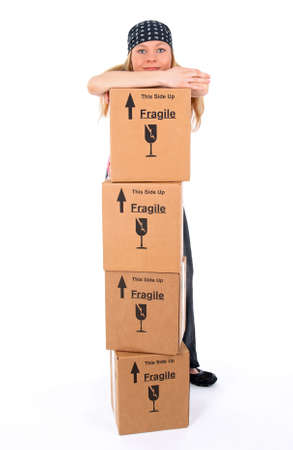 Girl standing behind a stack of cardboard boxes. Stock Photo - 2886555
