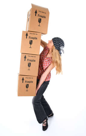 moving crate: Woman balancing with a stack of cardboard boxes, ready to fall.