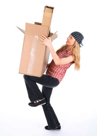 Girl balancing with cardboard boxes, white background. photo