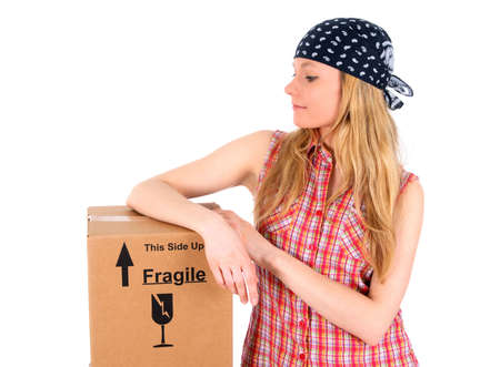 Cute girl wearing bandanna with a parcel delivered. photo