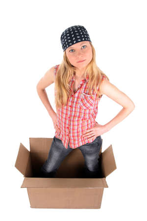 Girl standing in a cardboard box, looking up. Isolated on white. photo