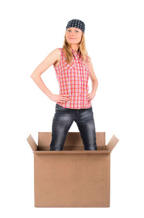 Proud young woman standing in a cardboard box. Isolated on white. Stock Photo - 2927176