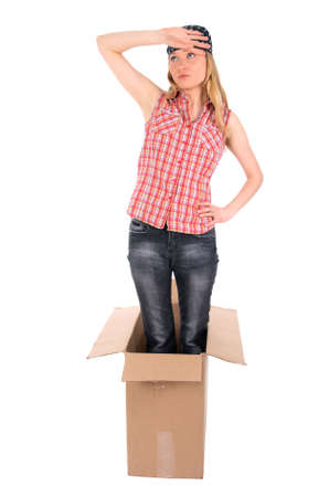 Tired girl standing in a cardboard box. Isolated on white.