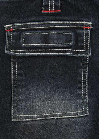 denim jeans: Closeup of square black denim jeans pocket. Stock Photo