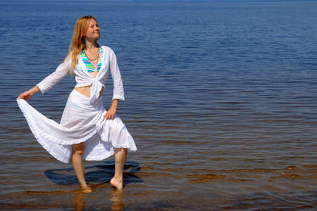 Pretty girl in white summer dress dancing in water. Stock Photo - 3566356