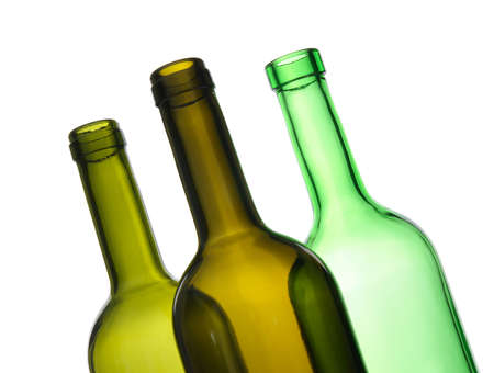 white wine bottle: Three green empty bottles on white background.