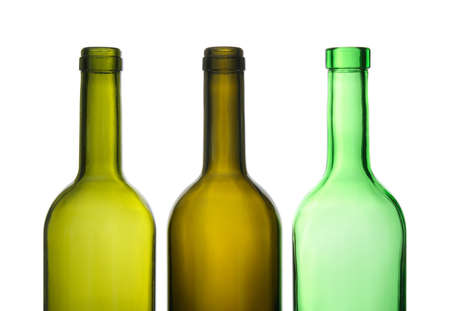 Three green empty wine bottles in a row. photo