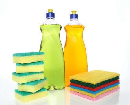Cleaning concept. Dishwashing liquid and sponges. photo