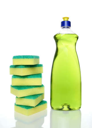 disinfect: Bottle of green dishwashing liquid and sponges on white background. Stock Photo