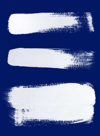 Texture of white brush strokes on blue background. photo
