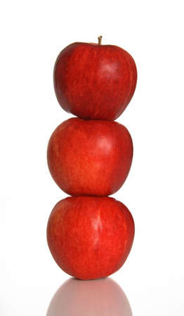top: Balance. Three red apples one on another.