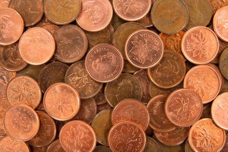 Background made of old and new Canadian 1 cent coins. photo