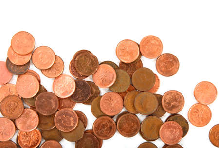 Close-up of old and new Canadian 1 cent coins on white background.