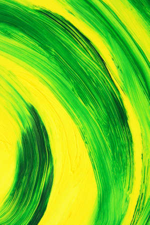 Green and yellow oil-painted abstract curves. Texture of brush strokes.