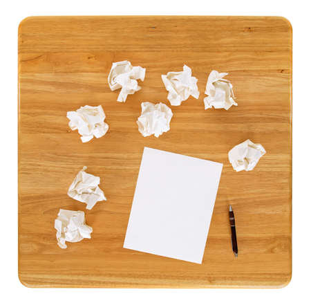 office desk: Creativity problems. Blank sheet of paper and crumpled paper wads.