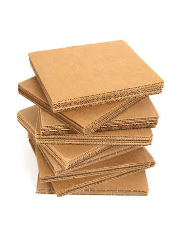 Stack of cardboard with copy space, isolated on white. photo