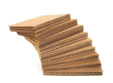 Falling stack of cardboard isolated on white background. Stock Photo - 4341892