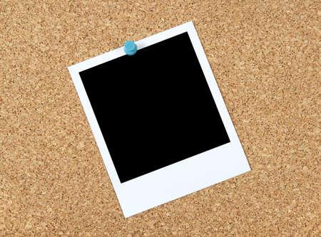 Blank photo pinned to corkboard. photo