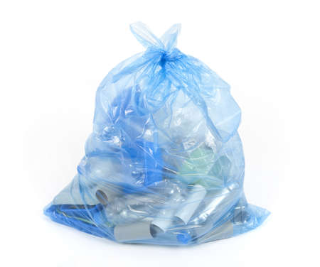 Blue bag with plastic and cardboard for recycling. photo