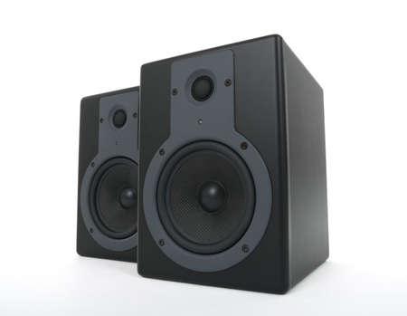 loud speakers: Pair of black loud speakers on white background.