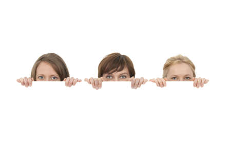 Three young women behind a blank banner ad, on white background.