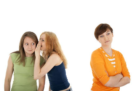 betray: Two girls whispering secrets to each other, and their friend, upset and rejected
