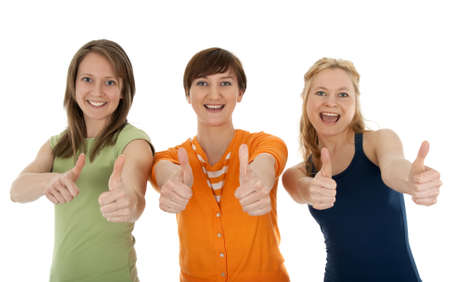Three happy and energetic young women giving thumbs up. Stock Photo