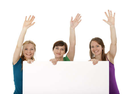 promotion girl: Three young women holding a blank banner, greeting and smiling. Stock Photo