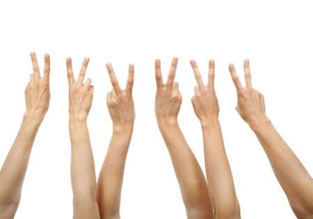 Handen blijkt overwinning ondertekenen, geïsoleerd op wit. Stockfoto