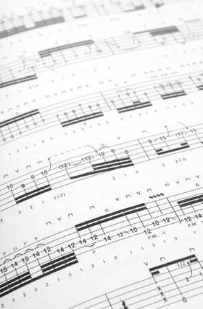 sheetmusic: Guitar tabs background. Shallow DOF.