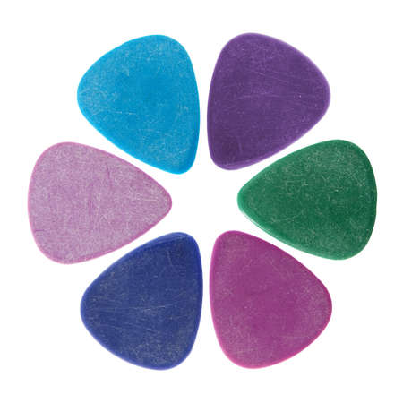 guitar pick: Flower made of colourful guitar picks, isolated on white.